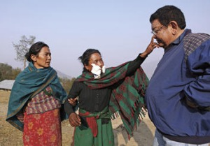 Healing touch … 20-year-old Ramsali Lagu Maya touches Ruit's nose on command after her eye patches are removed.