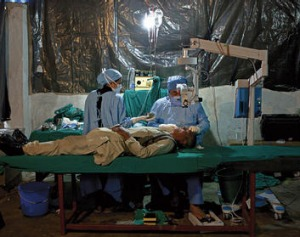 Delicate operation … Ruit works in the temporary operating theatre in a school in Manpur.