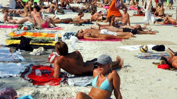 Thai tan time ... revellers soak up the sunshine on Sunrise Beach ahead of the Full Moon Party.