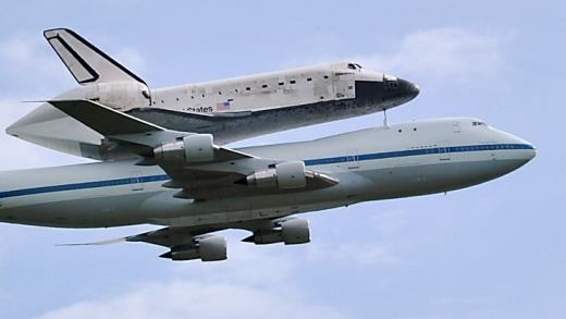 The space shuttle Discovery travels on the back of a Boeing 747 jumbo jet to its final destination - a museum outside ...