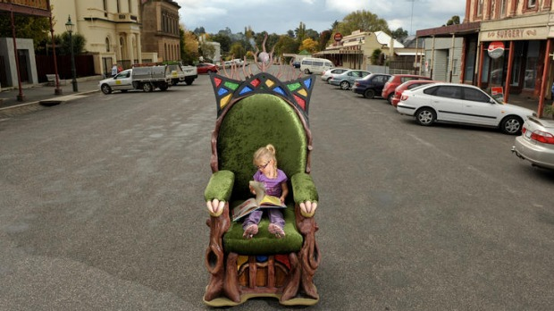 Georgia Hayne, 4, reads a book in the Clunes Book Festival's Narnia chair.
