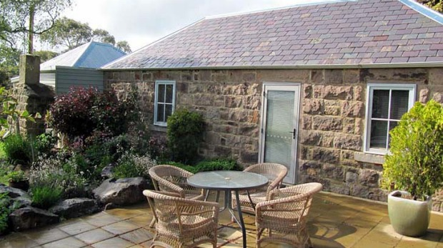 Snug and simple ... Sunnyside Cottage's deck and garden.