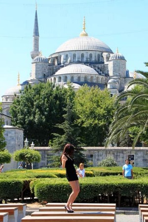 Spectacularly inappropriate ... a girl dances at Istanbul's Blue Mosque.