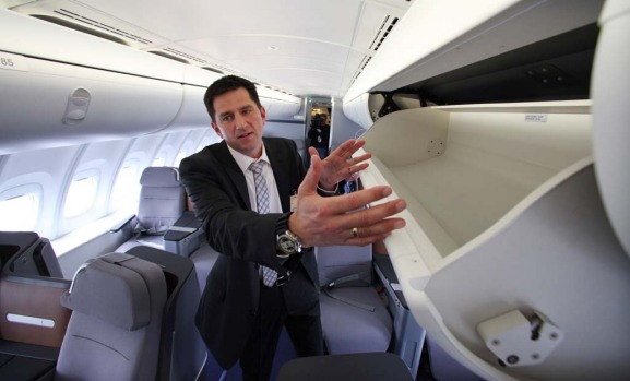 Lufthansa program manager for cabin development Steffen Voltz explains the larger overhead bins before delivery by ...