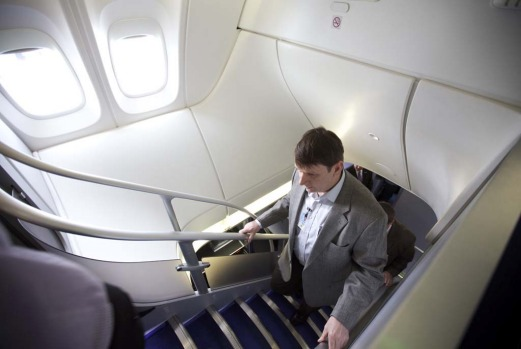 EVERETT, WA - MAY 1: A visitor makes his way up stairs on the Boeing 747-8 Intercontinental.