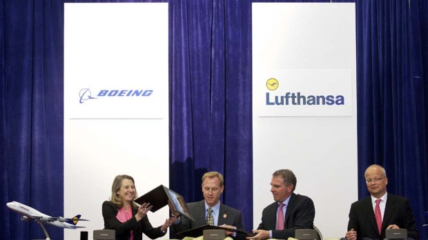 From left, Boeing 747 Program Vice President and General Manager Elizabeth Lund, Boeing Commercial Airplanes Senior Vice President Pat Shanahan, Deutsche Lufthansa AG CEO Carsten Spohr and Lufthansa Executive Vice President Nico Buchholz take part signing ceremony for Boeing the 747-8 Intercontinental.