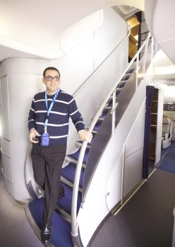 Boeing machinist Jose Diaz walks down the stairs on a Boeing 747-8 Intercontinental airliner.
