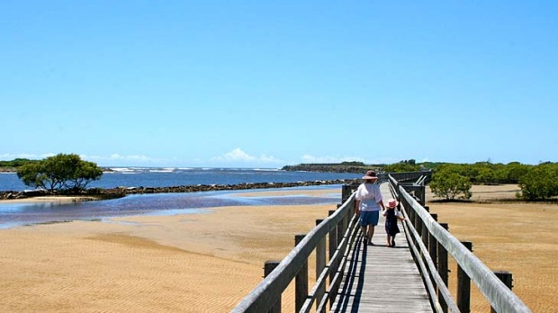 Coasting ... Urunga boardwalk stretches from the river to the beach and the mangroves.