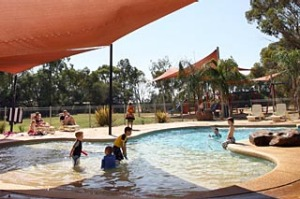 River idyll... children cool off in the pool.
