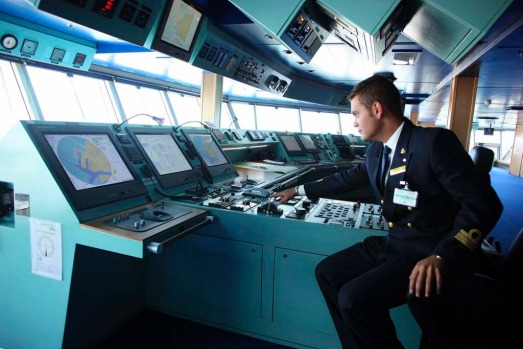 A navigation officer sits on the bridge of the new Costa Fascinosa ship at Venice harbour.