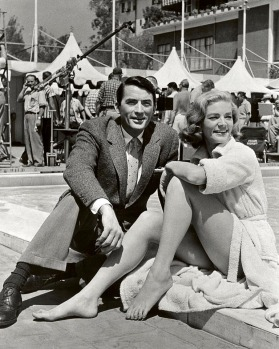 "Gregory Peck and Lauren Bacall on the set of ""Designing Woman"" at The Beverly Hills Hotel."