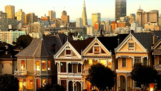 Victorian houses set against San Francisco's skyline.