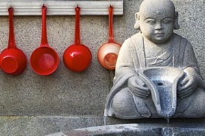 Buddhist temple fountain and drinking ladles.