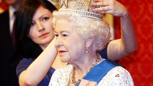 Keeley Scothern of Madame Tussauds waxworks museum London puts the finishing touches on a new figure of the Queen in ...