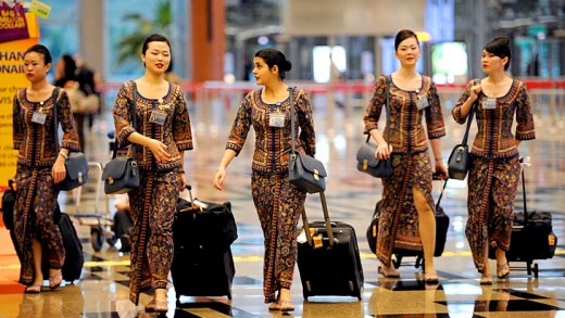 Singapore Girls ... Singapore Airlines flight attendants will now be able to serve for three more years.