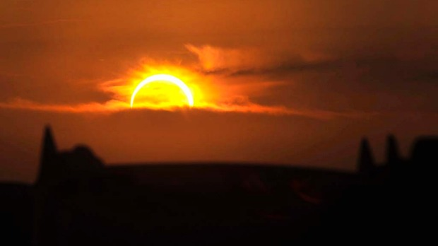 An annular eclipse seen near Cadillac Ranch, Texas.
