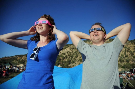 "Will Bowen, 29, of St George, Utah reacts as he see the perfect ""ring of fire"" annular solar eclipse in Kanarraville, Utah."