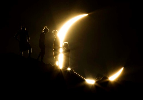 Hikers watch an annular eclipse from Papago Park in Phoenix.