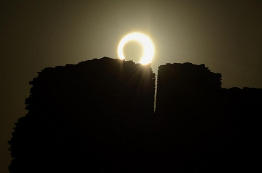The annular eclipse as seen over the Pueblo Bonito ancient building at Chaco Culture National Historical Park in ...