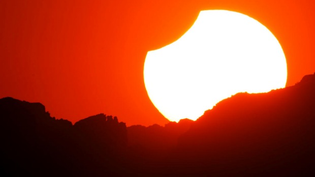 The first annular eclipse seen in the US since 1994 wanes to a partial eclipse as the sun sets in Grand Canyon.