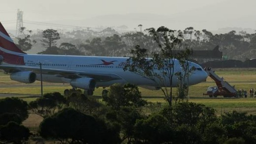Passengers disembark from the Air Mauritius Airbus that had taxied to a remote part of Melbourne Airport after the ...