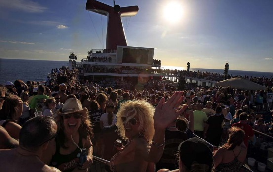 Fans crowd the deck of the Carnival Destiny ahead of Kid Rock's opening performance on the cruise.