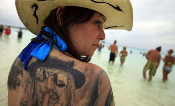 Roxie Decambra shows one of her many Kid Rock tattoos. The Kid Rock cruise  kicks off this year's music cruise season in ...
