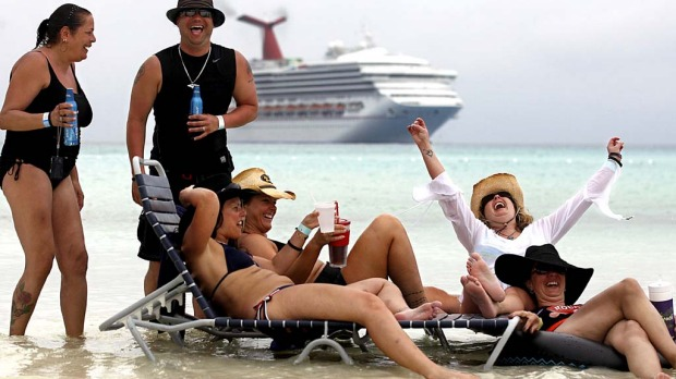 Fans rest in the water at Half Moon Cay, the Bahamas, christened 'Red Neck Paradise' by Kid Rock for the cruise.