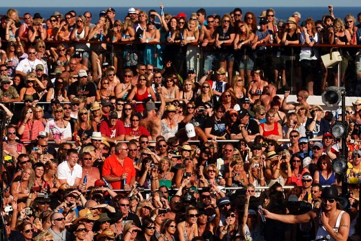 Fans gather on deck during the cruise hosted by musician Kid Rock, bottom right.