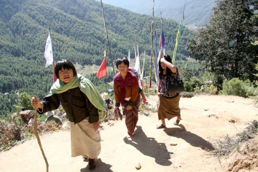 Bhutanese women in national dress walking to Tiger's Nest monastery.