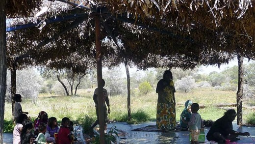Artists under the shade of the bough shelter.