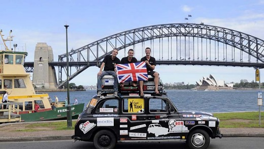 Paul Archer, Johno Ellison and Leigh Purnell on their black taxi.