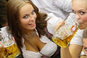 Women wearing traditional Bavarian Dirndl pose with beer during the opening ceremony for the 176th Oktoberfest in Munich ...