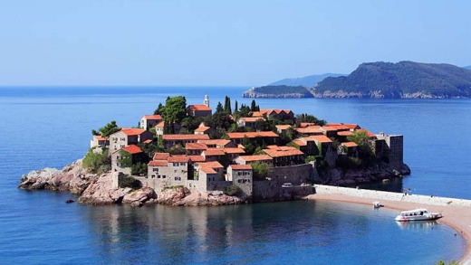 Instantly recognisable ... Sveti Stefan - the beautiful little islet off the Adriatic just south of Budva, connected to ...