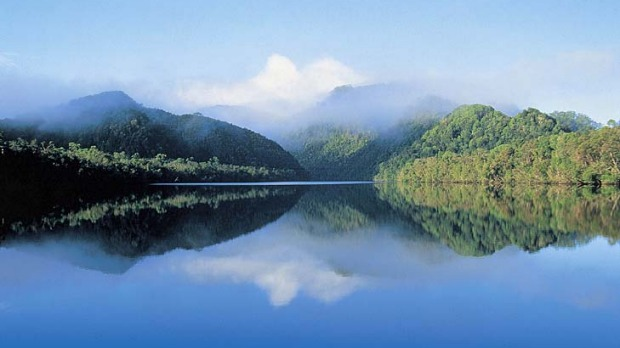 Still waters... the Gordon River provides for a fluid landing between mountains.