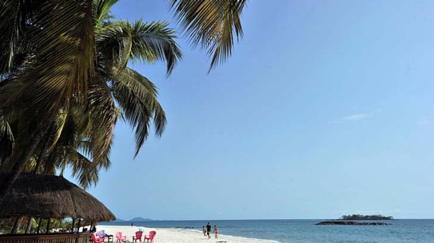 Sierra Leone is home to some of Africa's most beautiful scenery - like the palm-fringed Tokeh Beach - but is suffering ...