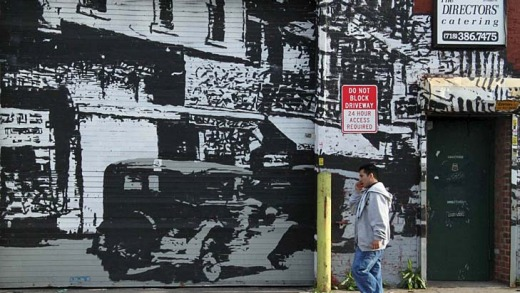 A black-and-white movie scene plays out on a Brooklyn wall.