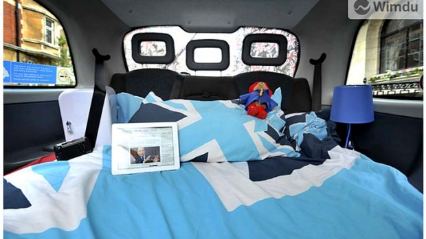 Night rider ... a London cabbie has turned his taxi into a hotel for one, complete with mattress, teddy bear, tables, ...