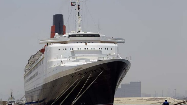 The QE2 is currently moored in Port Rashid in Dubai - a gritty commercial port a long way from the tourist-friendly ...
