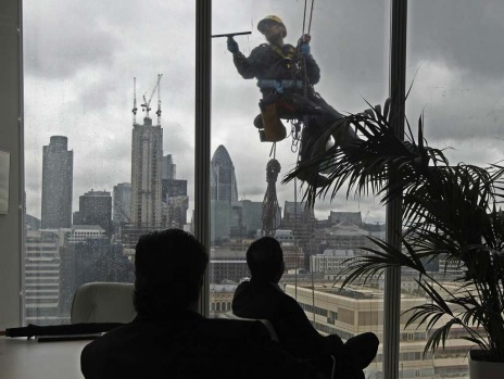 A window cleaner works outside the 14th floor at the Shard in London.