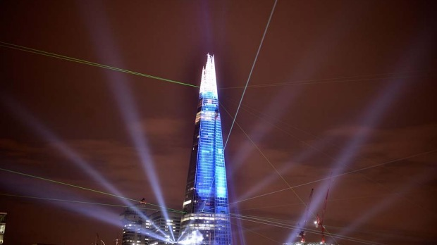 The Shard during a laser light show from Tower Millennium Pier in London.  The European Union's tallest building, designed by Italian architect Renzo Piano, stands at 310 metres tall.