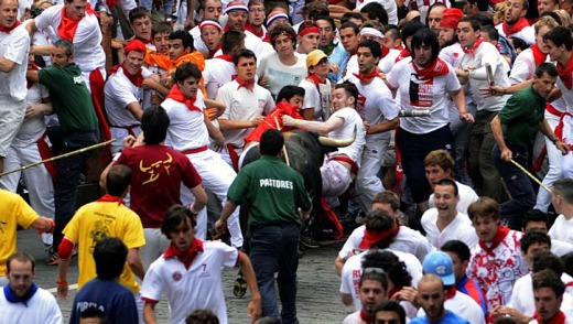 Refusing to run ... Fugado, a 545 kg Cebada Gago fighting bull turns back on the crowd during the running of the bulls ...