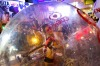 A go-go dancer (C) performs inside a plastic bubble in Sant Antoni de Portmany on Ibiza. Driven by a soaring jobless ...