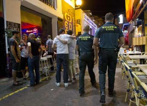 Two civil guards patrol past tourists on Ibiza. 'There is a reputation that people come here for out-of-control ...