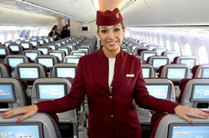 A flight attendant for Qatar Airways poses in the economy class cabin of the new Boeing 787 Dreamliner at the ...