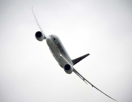 The Qatar Airways Boeing 787 Dreamliner takes part in a flying display at the Farnborough International Air Show.