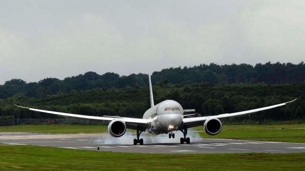 The Qatar Airways Boeing 787 Dreamliner lands after performing a display flight at the Farnborough Air Show.