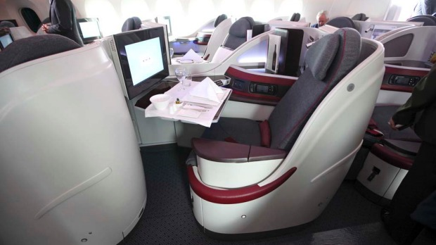 The interior of a Qatar Airways business class cabin on board its Boeing 787 Dreamliner.