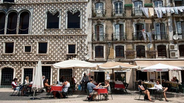 Luminous Lisbon... cafe life in the Alfama district.