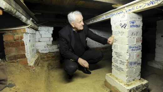 73-year-old Ross Thomas of Chapman, inspects markings on the wall.